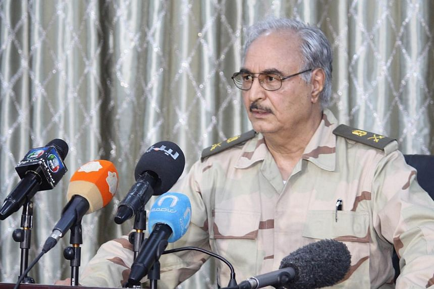 A picture made available on 20 May 2014 shows retired Libyan General Khalifa Haftar during a press conference in Abyar, a small town to the east of Benghazi, Libya, on 17 May 2014. -- EPA
