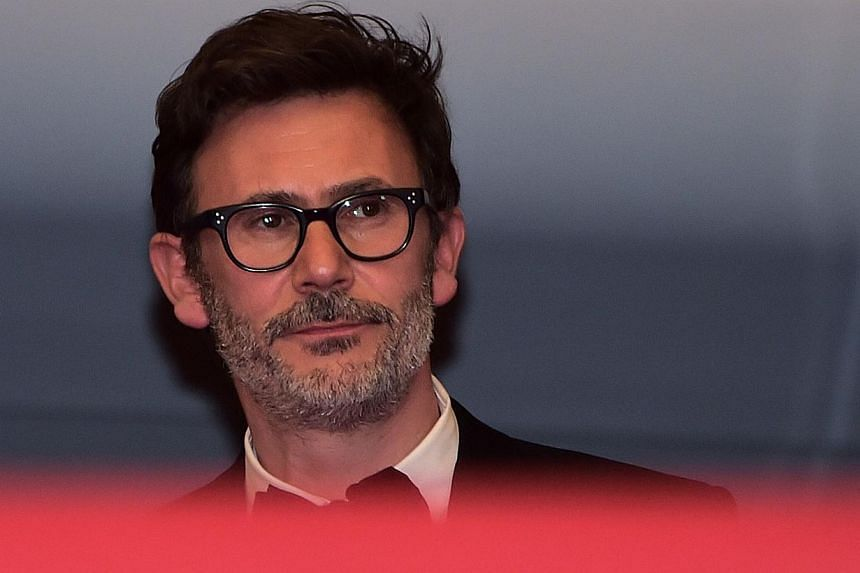"""French director Michel Hazanavicius leaves after after the screening of the film """"The Search"""" at the 67th edition of the Cannes Film Festival in Cannes, southern France, on May 21, 2014.Michel Hazanavicius followed up his Oscar winner with a Ch"""