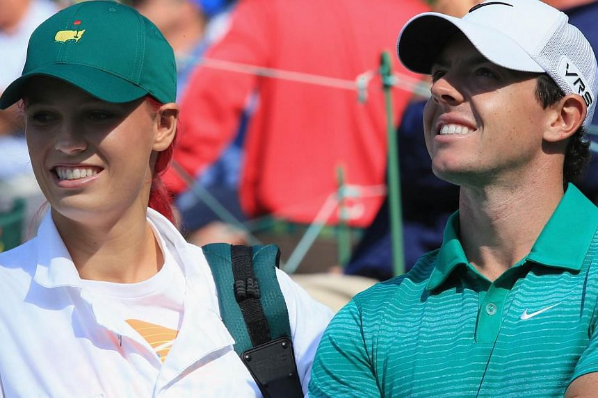 Rory McIlroy alongside his then girlfriend Caroline Wozniacki during the 2014 Par 3 Contest prior to the start of the 2014 Masters Tournament at Augusta National Golf Club on April 9, 2014 in Augusta, Georgia. -- PHOTO: AFP