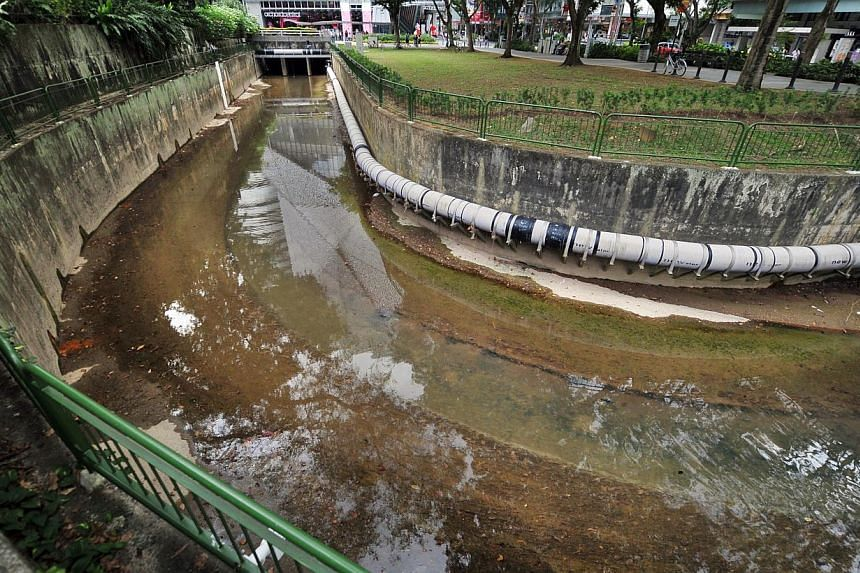 The Stamford Canal at the junction of the Orchard and Killiney Roads. The new diversion canal will connect the upstream section of Stamford Canal to the Singapore River. -- PHOTO: ST FILE