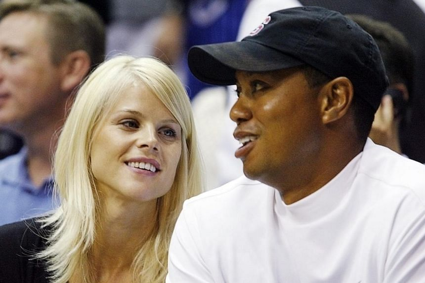 Tiger Woods and his wife Elin Nordegren (left) watch Game 4 of the NBA Finals basketball game in Orlando, Florida in this June 11, 2009, file photo.The former wife of Tiger Woods said she has a good relationship with the golfer and called him a