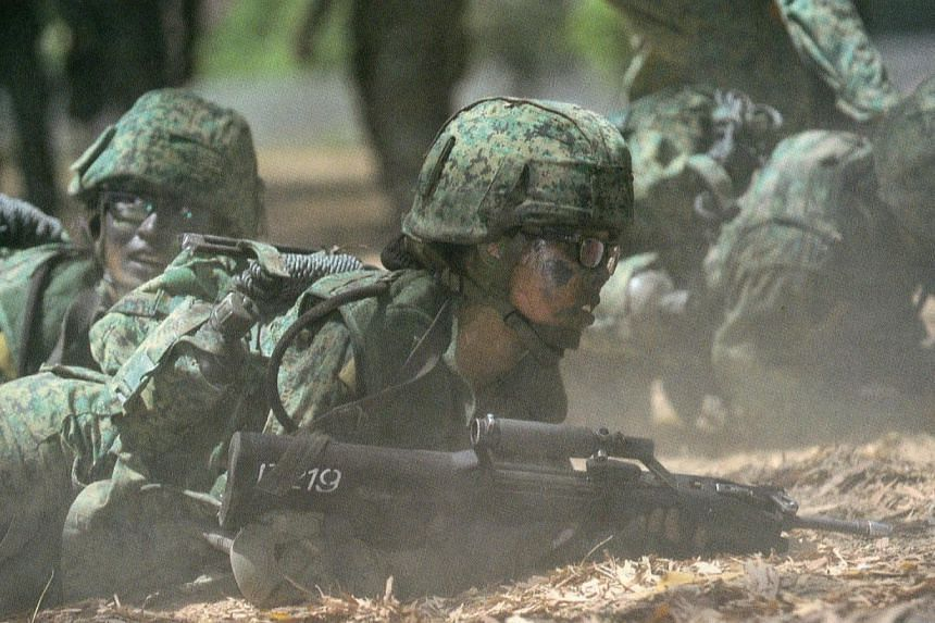 A female recruit from the Singapore Armed Forces (SAF) undergoing training. -- PHOTO: PIONEERNS