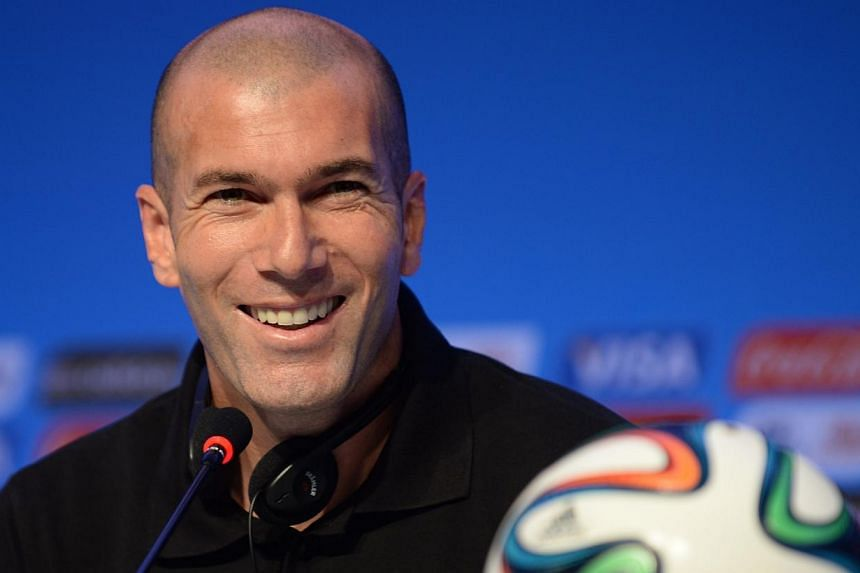 This file picture dated on Dec 5, 2013 shows French footbal star Zinedine Zidane giving a press conference on the eve of the Brazil 2014 FIFA Football World Cup final draw, in Costa do Sauipe, state of Bahia. -- PHOTO: AFP