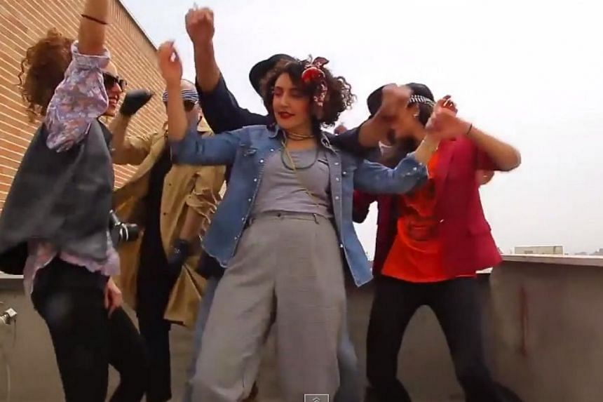 A screengrab from the video of six young Iranians dancing on rooftops to US singer Pharrell Williams' hit Happy. The six were arrested for the video but have since been released on bail. -- PHOTO: SCREENGRAB FROM YOUTUBE