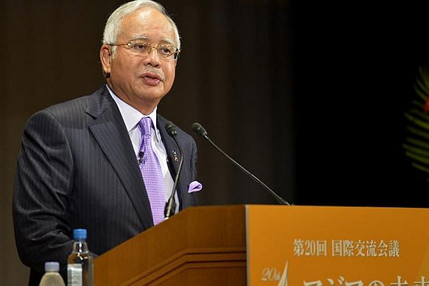 Malaysia PM Najib Razak gives his keynote speech at the 20th Nikkei Conference in Tokyo, Japan. -- ST PHOTO: JAMIE KOH