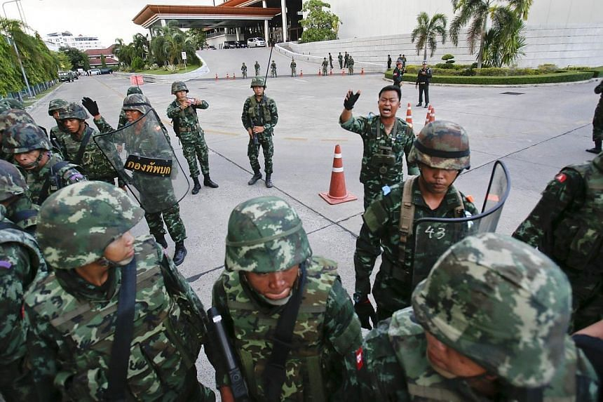 Thai soldiers take control during a coup at the Army Club where Thailand's army chief held a meeting with all rival factions in central Bangkok on Thursday, May 22, 2014. -- PHOTO: REUTERS