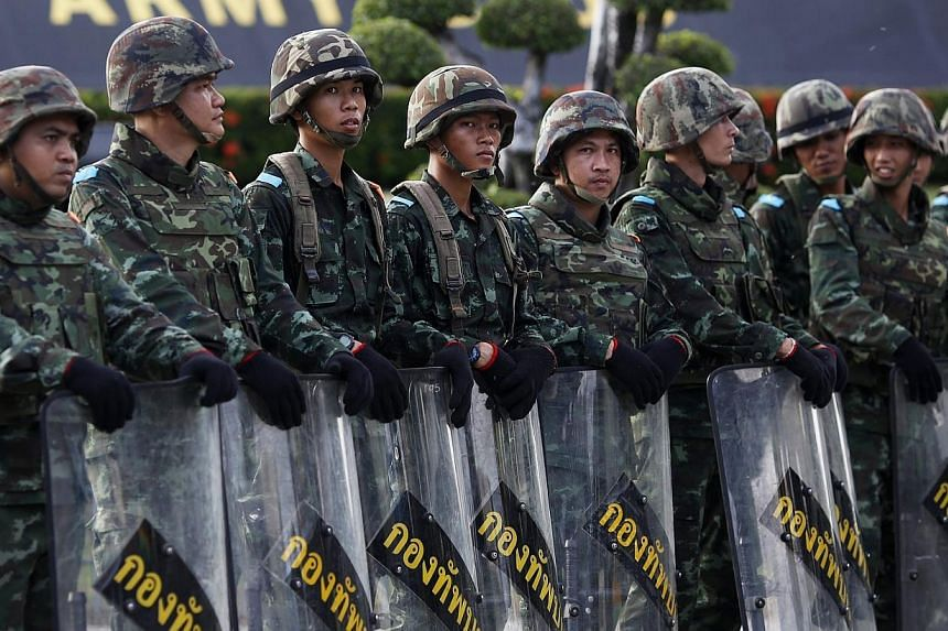 Soldiers block the access to the Army Club where Thailand's army chief held a meeting with all rival factions during a coup in central Bangkok on Thursday, May 22, 2014. -- PHOTO: REUTERS