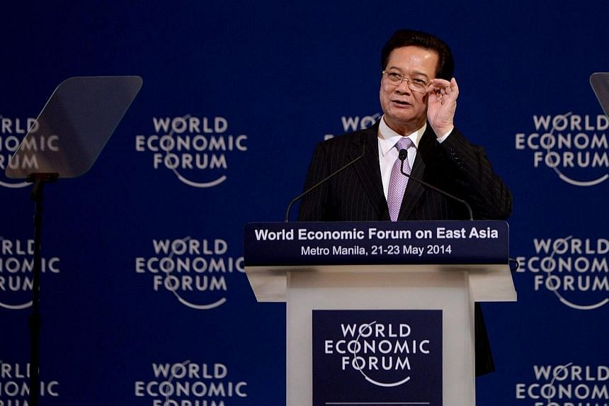 Vietnam Prime Minister Nguyen Tan Dung speaks during the World Economic Forum on East Asia in Manila on May 22, 2014. -- PHOTO: AFP