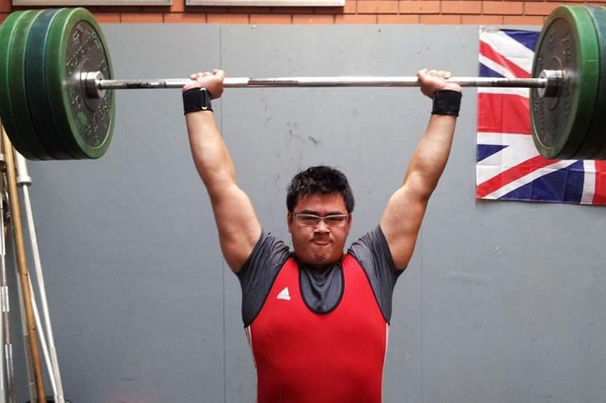 National weightlifter Scott Wong training in 2013. Wong willtake part in the Glasgow Commonwealth Games from July 23 to Aug 3after the Singapore National Olympic Council approved his selection on Thursday. -- PHOTO: COURTESY OF SCOTT WONG