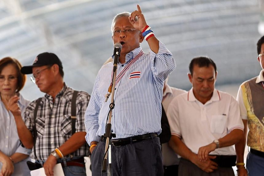 Thai anti-government protest leader Suthep Thaugsuban (centre) speaks to his followers next to core leaders during a rally at Democracy Monument in Bangkok, Thailand on Thursday, May 22, 2014. -- PHOTO: EPA
