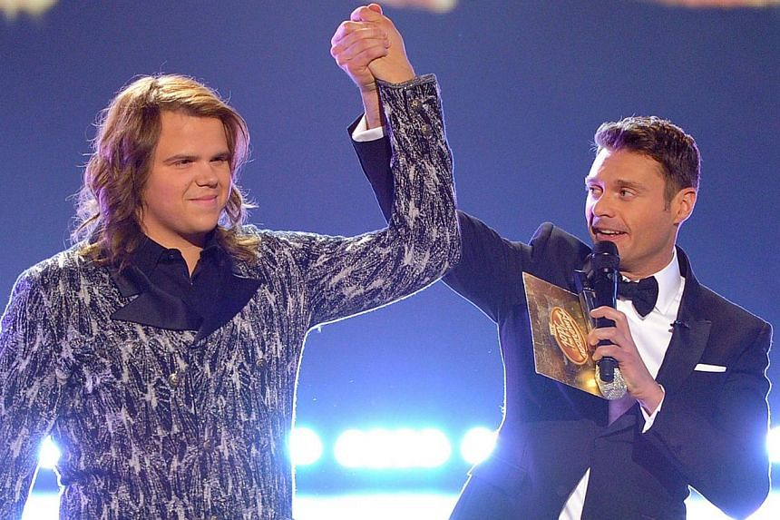 Host Ryan Seacrest (right) announces Caleb Johnson as the winner onstage during Fox's American Idol XIII Finale at Nokia Theatre L.A. Live in Los Angeles, California on May 21, 2014. -- PHOTO: AFP