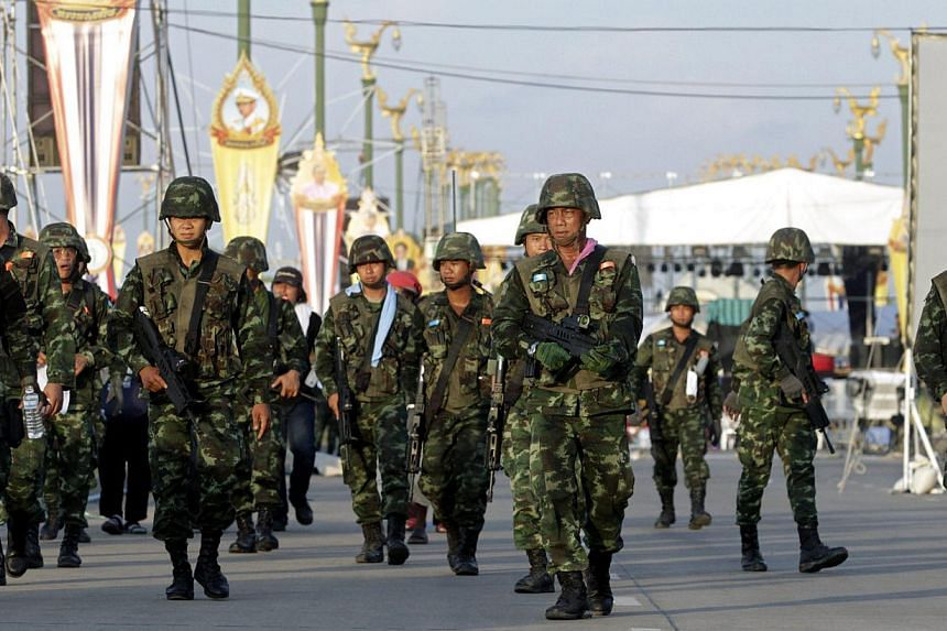 Thai soldiers patrol to clear Red Shirt pro-government supporters after the army declared coup at the rally site on the outskirts of Bangkok, Thailand, on May 22, 2014. -- PHOTO: EPA