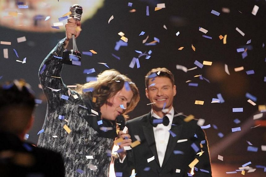 Host Ryan Seacrest (right) announces Caleb Johnson as the winner onstage during Fox's American Idol XIII Finale at Nokia Theatre LA Live on May 21, 2014 in Los Angeles, California. -- PHOTO: AFP