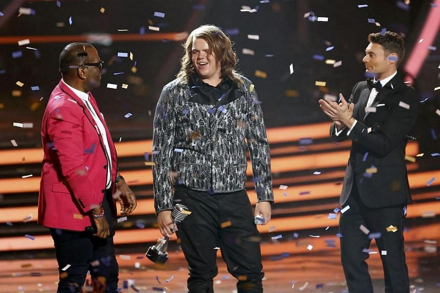 Randy Jackson (left) and show host Ryan Seacrest congratulate winner Caleb Johnson on stage during the American Idol XIII 2014 Finale in Los Angeles, California on May 21, 2014. -- PHOTO: REUTERS
