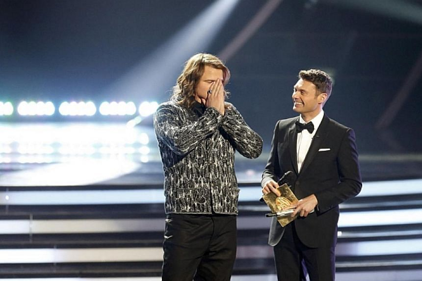 Caleb Johnson reacts after being named winner by host Ryan Seacrest during the American Idol XIII 2014 Finale in Los Angeles, California on May 21, 2014. -- PHOTo: REUTERS
