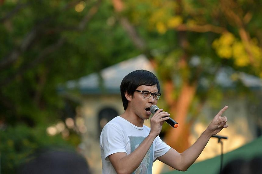 Blogger Roy Ngerng speaking at the Labour Day protest at Hong Lim Park on May 1, 2014.Prime Minister Lee Hsien Loong will not be dropping his demand for damages and legal costs from Mr Ngerng, his lawyer Senior Counsel Davinder Singh said in a