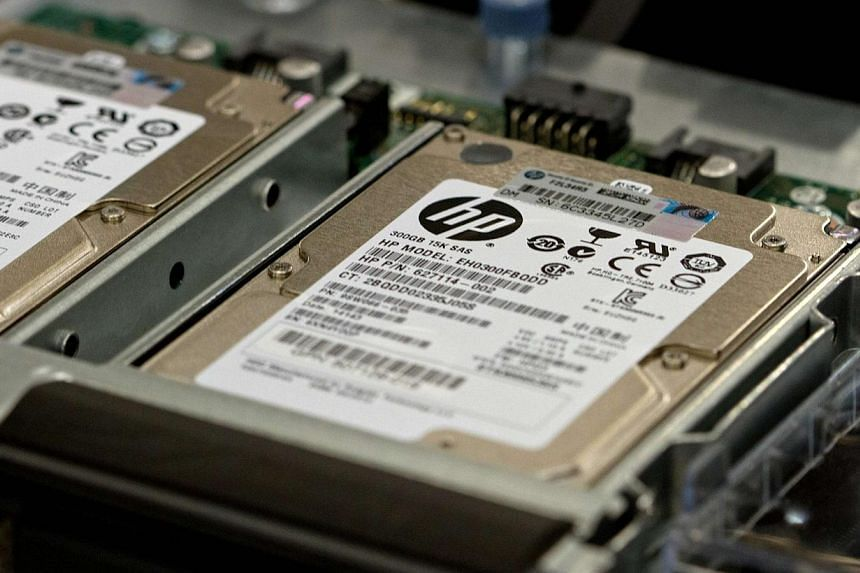 Hewlett-Packard ProLiant commercial data servers are assembled by workers at a company manufacturing facility in Houston in on Nov 19, 2013. Hewlett-Packard Co plans to cut as many as 16,000 more jobs in a major ramp-up of CEO Meg Whitman's years-lon