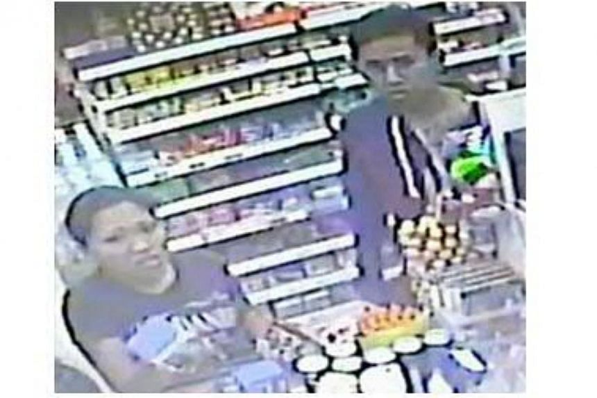 Police are looking for a man and woman to assist with investigations into a case of shop theft at a convenience store in Hougang Avenue 8 on April 28. -- PHOTO: SINGAPORE POLICE FORCE
