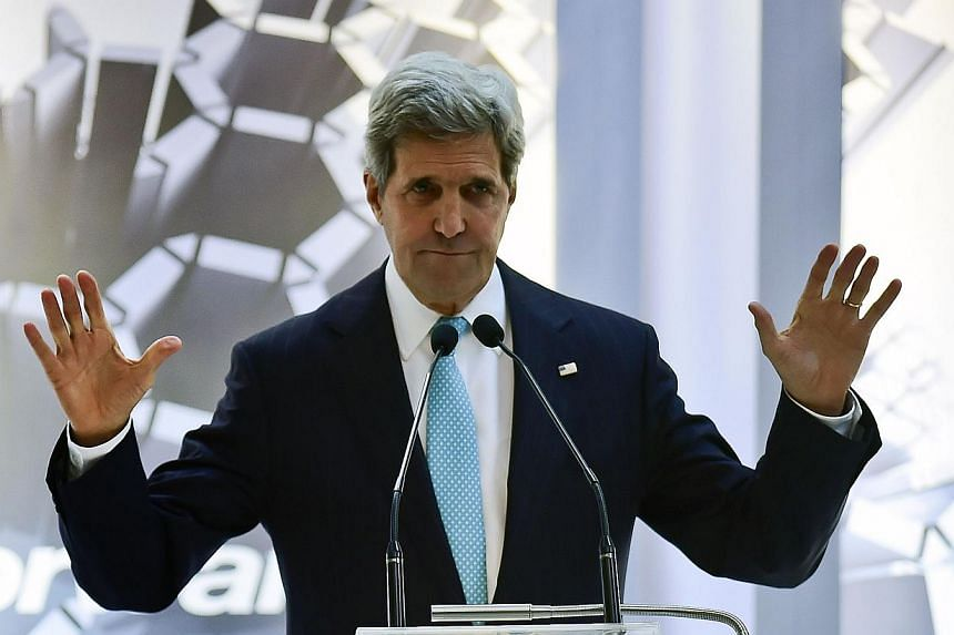 US Secretary of State John Kerry gestures during a conference in the framework of the Cleantech Challenge Mexico 2014, in Mexico City on May 21, 2014. -- PHOTO: AFP
