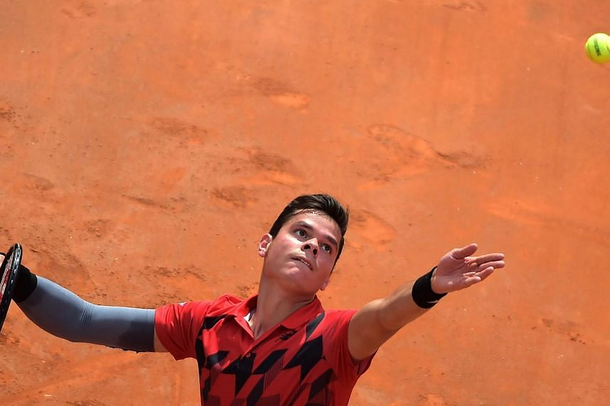 Milos Raonic of Canada serves during his ATP-WTA Rome's Tennis Masters semi-final against Novak Djokovic of Serbia at the Foro Italico in Romeon May 17, 2014. -- PHOTO: AFP