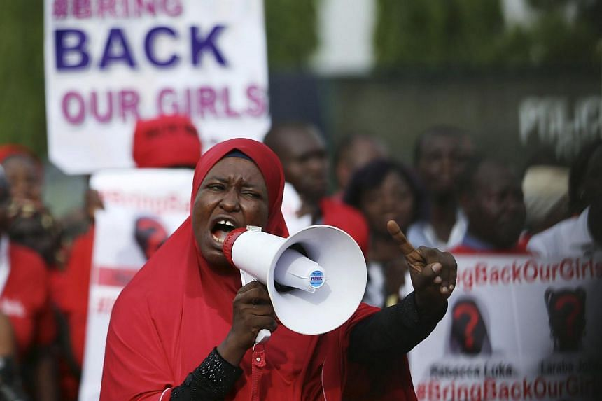 "A protester addresses the ""Bring Back Our Girls"" protest group as they march to the presidential villa to deliver a protest letter to Nigeria's President Goodluck Jonathan in Abuja, calling for the release of the Nigerian schoolgirls in Chibok who we"