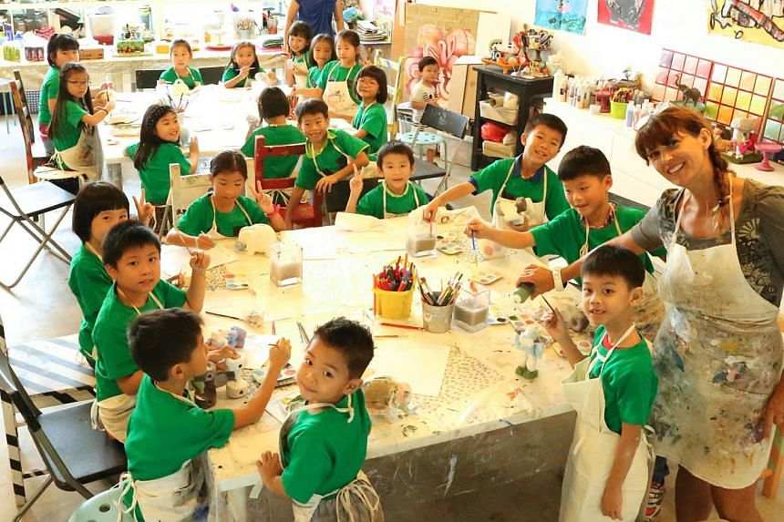 Ariel Goh and her friends painted ceramic objects at her party. --PHOTO: COURTESY OF PHILIP GOH