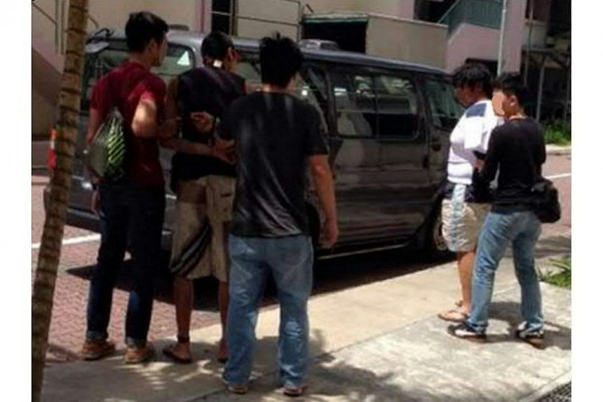 Suspects being arrested by Central Narcotics Bureau officers during one of the operations conducted from Monday to Thursday. -- PHOTO: CENTRAL NARCOTICS BUREAU