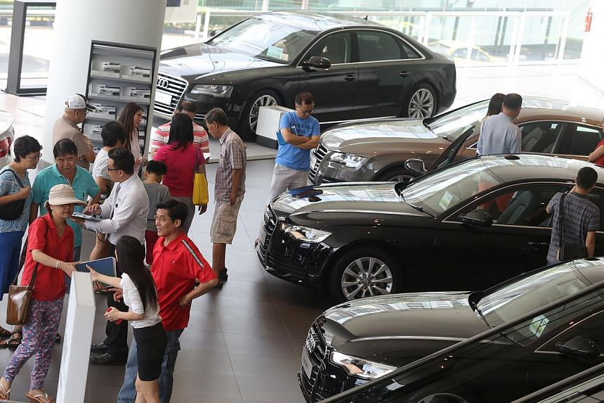 Potential car buyers at the Audi showroom at Alexandra Road. -- PHOTO: ST FILE