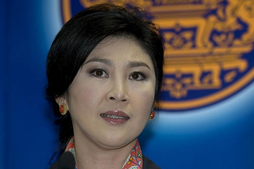 Thailand's former prime minister Yingluck Shinawatra reported to the kingdom's military junta on Friday, an aide said. -- PHOTO: AFP