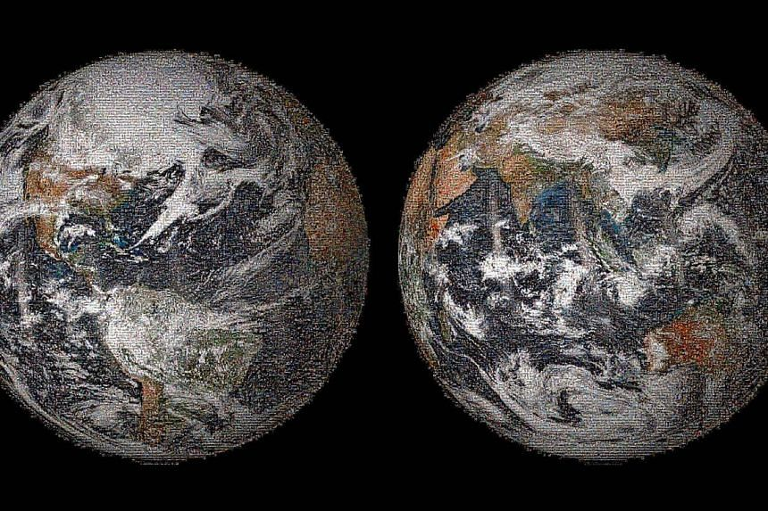 """This image released on May 22, 2014 by NASA shows the """"Global Selfie"""" Earth mosaic containing more than 36,000 individual photographs from the more than 50,000 images posted around the world on Earth Day, on April 22, 2014. -- PHOTO: AFP"""