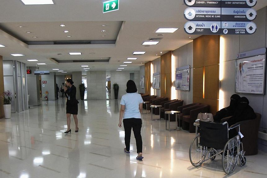 People walk inside a Bangkok hospital on May 19, 2014.Thailand is in danger of losing its crown as the world's top destination for medical tourism if foreigners looking for low-cost, quality healthcare are scared off by political unrest, especi