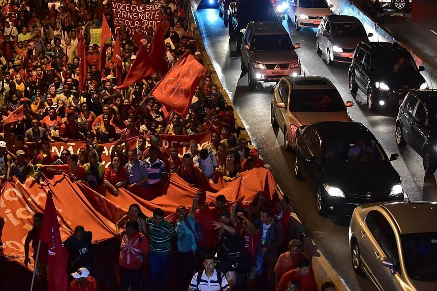 Members of social movements and students take part in a demonstration against the upcoming 2014 Fifa World Cup, in Sao Paulo, Brazil on May 22, 2014. -- PHOTO: AFP