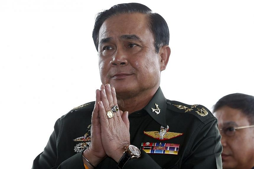 Thai army chief General Prayuth Chan-ocha gives a traditional greeting as he arrives for a meeting at the Army Club in Bangkok, Thailand on May 20, 2014. -- PHOTO: EPA