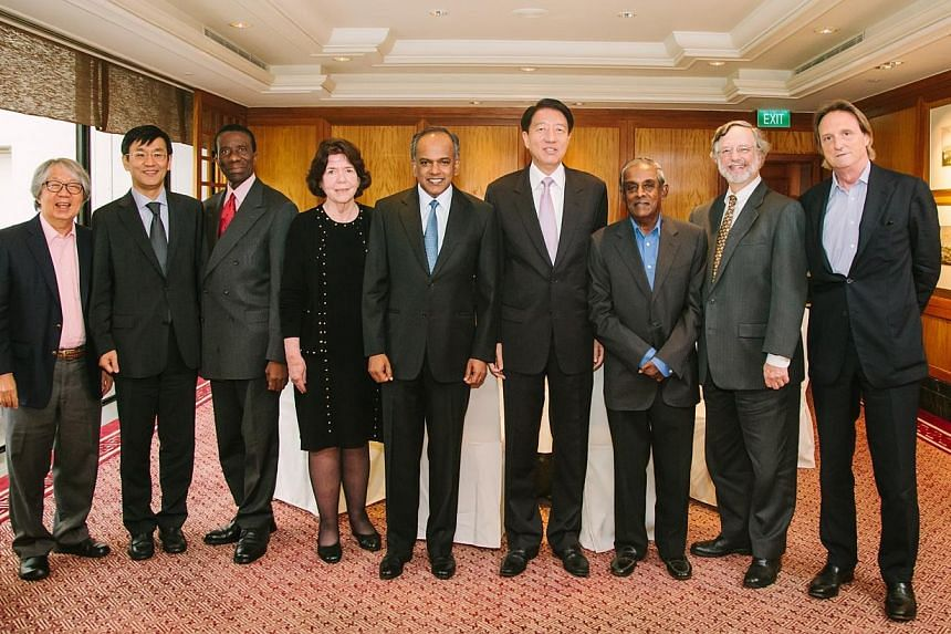 Deputy Prime Minister Teo Chee Hean (fourth from right), Law and Foreign Affairs Minister K. Shanmugam (centre) and the International Advisory Panel on Transboundary Pollution, comprising (from left) Ambassador-at-large Tommy Koh,