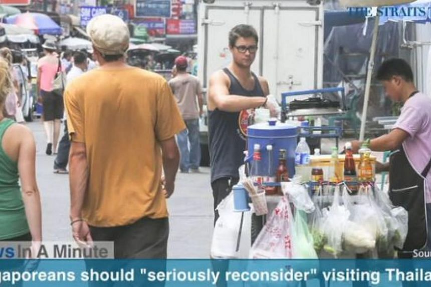 """In today's The Straits Times News In A Minute video, we look at how the Foreign Affairs Ministry has issued a travel notice asking Singaporeans to """"seriously reconsider visiting Thailand at the moment"""", among other issues.-- PHOTO: SCREENGRAB F"""