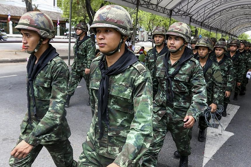 Soldiers march near the Government House after anti-government protesters were removed off the site following the coup being declared in Bangkok, Thailand on May 23, 2014. -- PHOTO: EPA