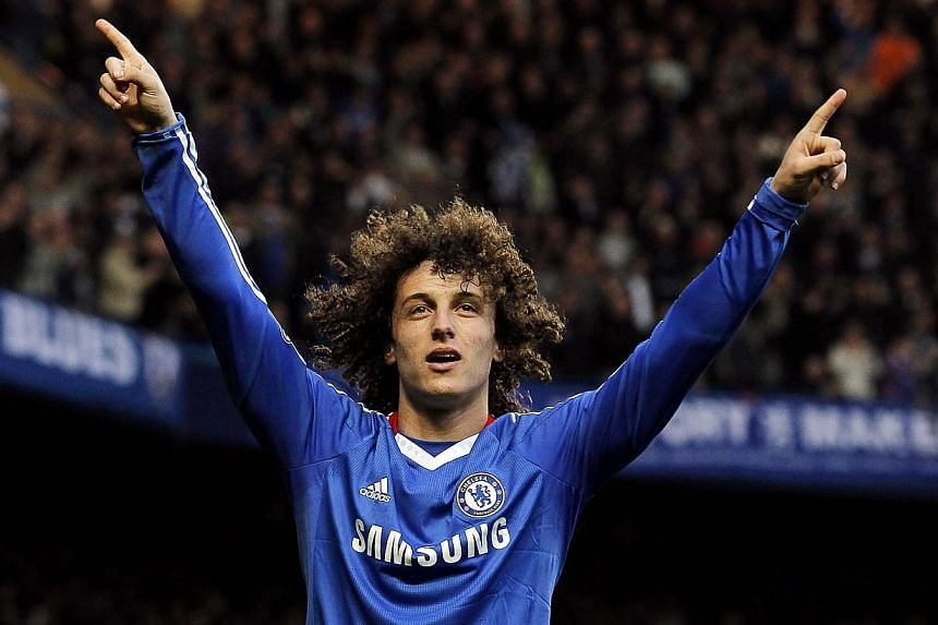 David Luiz is on the verge of joining Paris St Germain after Chelsea on Friday revealed they have agreed a deal to sell the Brazil defender to the French champions. -- PHOTO: EPA