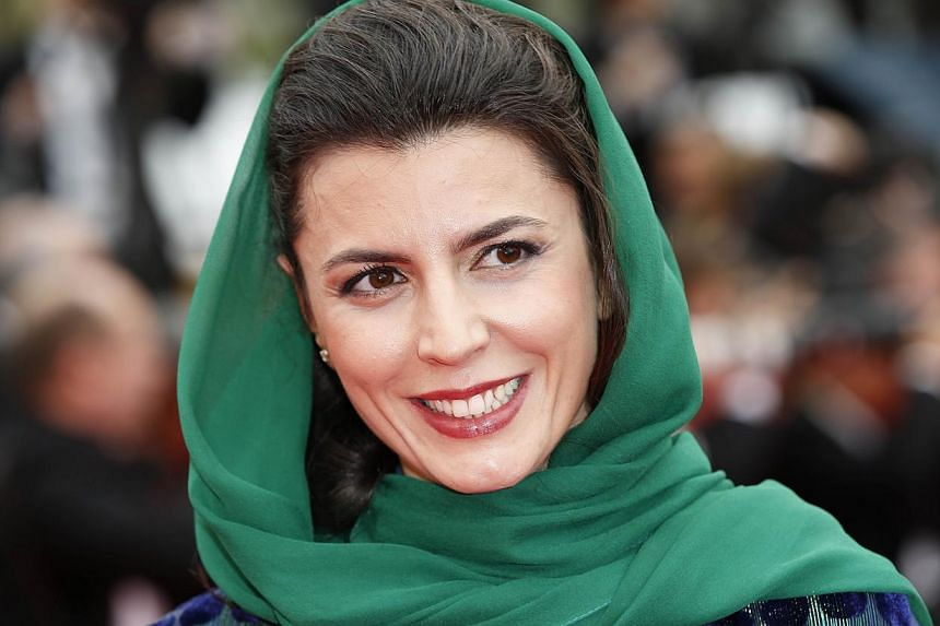 "Iranian actress and member of the Feature films Jury, Leila Hatami smiles as she arrives for the screening of the film ""Jimmy's Hall"" at the 67th edition of the Cannes Film Festival in Cannes, southern France, on May 22, 2014. -- PHOTO: AFP"