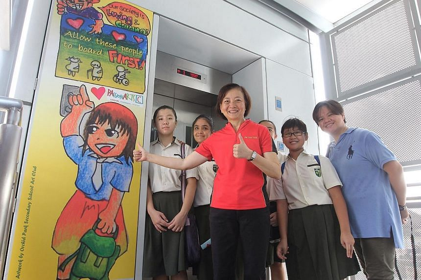 Residents, grassroots leaders and school students, together with Nee Soon GRC MP Lee Bee Wah, came together to paint lift doors and litter bins to spread the message of giving way to the elderly and not littering. -- ST PHOTO: NEO XIAOBIN