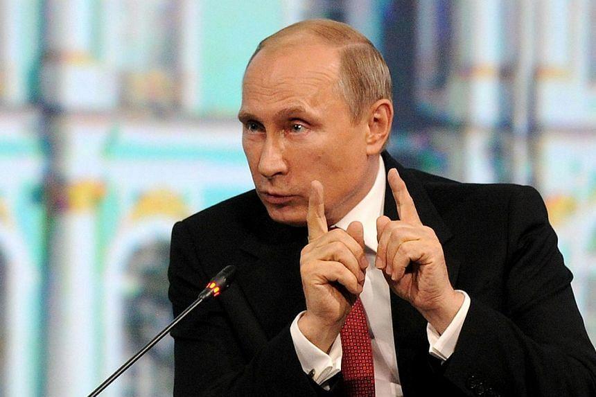 Russia's President Vladimir Putin speaks at the St. Petersburg International Economic Forum 2014 (SPIEF 2014) in St. Petersburg on May 23, 2014. -- PHOTO: AFP