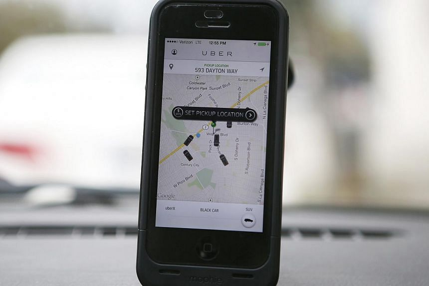 An Uber app is seen on an iPhone in Beverly Hills, California on Dec 19, 2013. -- PHOTO: REUTERS