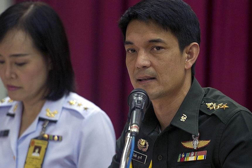 Thai deputy army spokesman Colonel Winthai Suwari (right) speaks during a press conference at Army Club in Bangkok on May 24, 2014. -- PHOTO: AFP