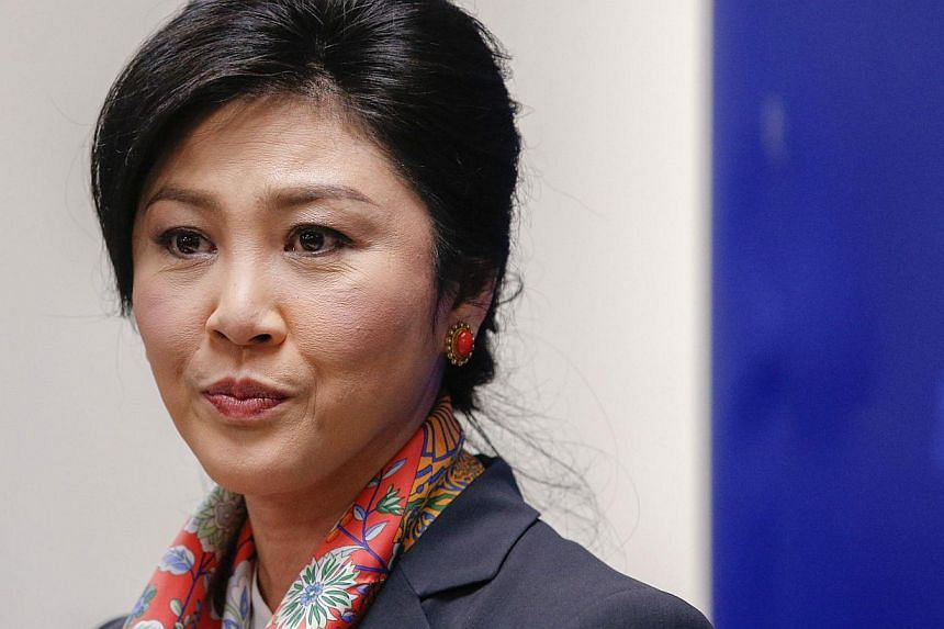 Thailand's Prime Minister Yingluck Shinawatra pauses as she addresses reporters in Bangkok on May 7, 2014. -- PHOTO: REUTERS