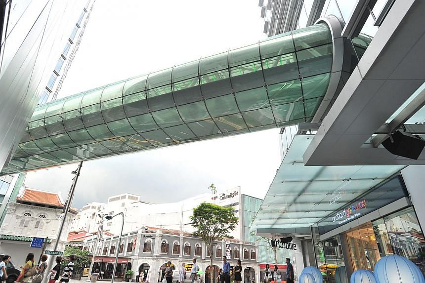 Orchardgateway's separate blocks are linked by a 53m overhead glass bridge and an underground walkway with retail offerings. -- PHOTO: ST FILE