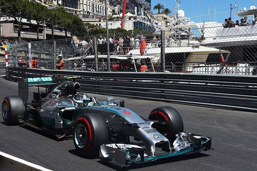 Mercedes' German driver Nico Rosberg drives at the Monaco street circuit during the qualifying session of the Monaco Formula One Grand Prix in Monte Carlo on May 24, 2014. -- PHOTO: AFP