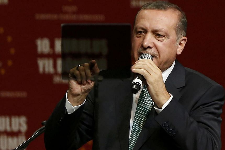 Turkish Prime Minister Tayyip Erdogan speaks to supporters during his visit in Cologne on May 24, 2014. - PHOTO: REUTERS