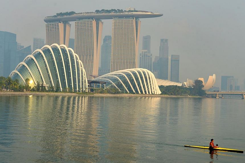 A paddler in a kayak along the Marina Bay on June 29, 2013.A plan to release several hundred balloons at a Marina Barrage charity carnival was burst after environmentalists convinced organisers of the harm that could be done to marine life. --