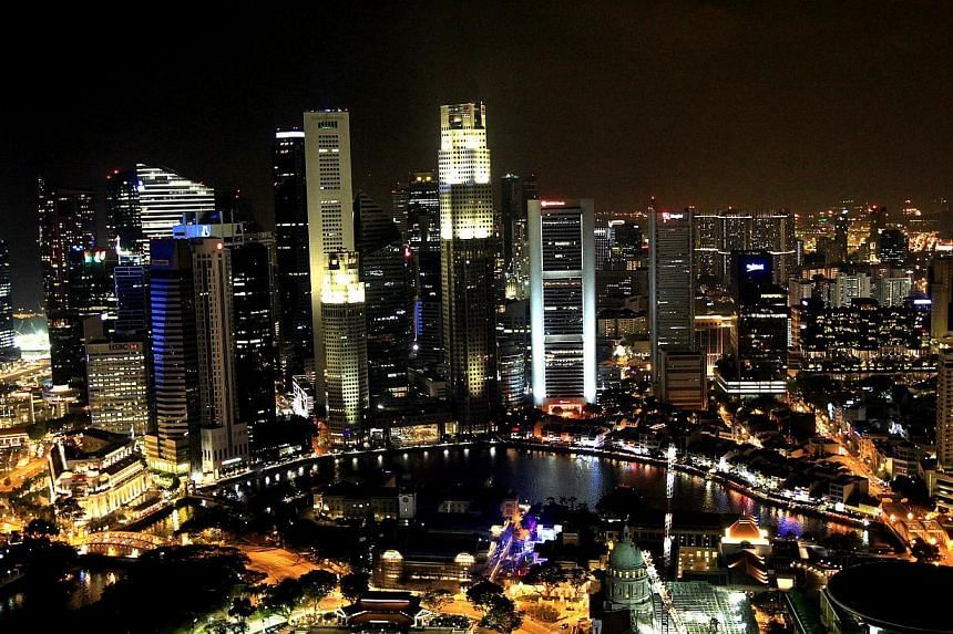 An aerial view of the Marina Bay skyline taken from Swissotel The Stamford on March 29, 2014. -- FILE PHOTO: ST
