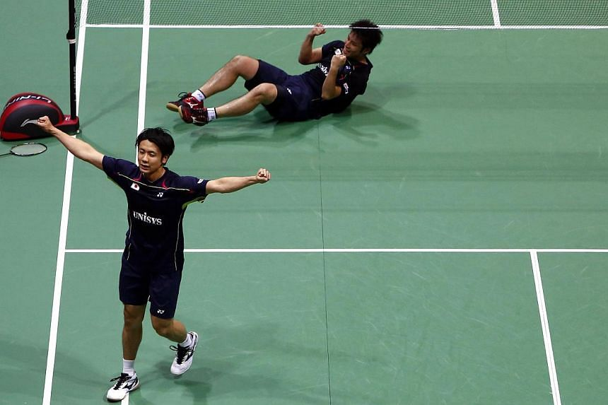 Japan's Hiroyuki Endo (L) and Kenichi Hayakawa celebrate after they defeated Malaysia's Tan Boon Heong and Hoon Thien How in the men's doubles final match in the Thomas Cup badminton championship in New Delhi May 25, 2014. -- PHOTO: REUTERS