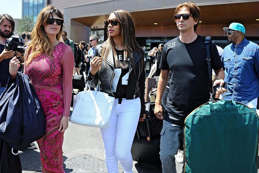Jonathan Cheban (second, right), Brittny Gastineau (second, left) and Lala Anthony (centre) arriving to Florence to attend the wedding of Kim Kardashian and Kanye West, in Florence, Italy, on May 24, 2014. -- PHOTO: EPA.